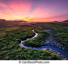 Lake during dry season at sunset