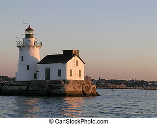 Lake Erie Light house at the mouth of the Cuyahoga river at sunset.