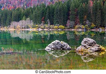 Lake Fusine ( Lago di Fusine) mountain lake in north Italy -...