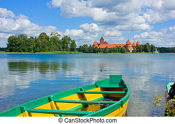 Lake Galve in Trakai, Lithuania - boat and casrle at lake ...