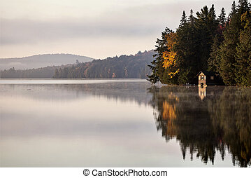 Lake in Autumn sunrise reflection - Lake in Autumn Algonquin...