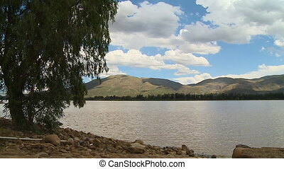 Lake In Front of Mountains - Steady, medium wide, exterior...