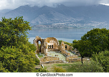 Lake in Greece - Landscape with the ruins of the Basilica of...