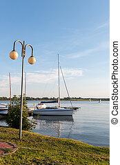 Lake in Ryn, Masuria. - Boat on the lake in Ryn, Masurian...