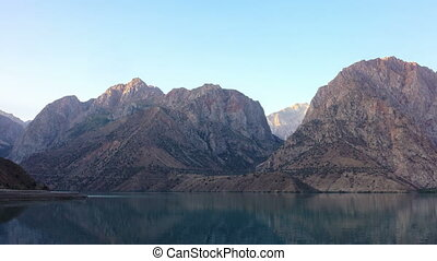 Lake in the mountains at dawn. Time Lapse. Tajikistan, Iskanderkul