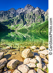 Lake in the mountains at sunrise in summer, Poland, Europe