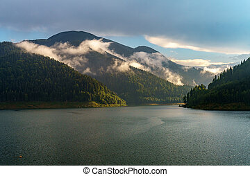 Lake in the mountains at sunset