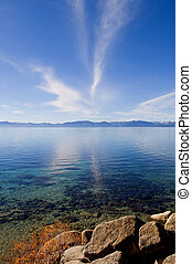 Lake in the mountains - Lake Tahoe with clouds over it
