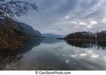 lake in the mountains with fog and rain clouds on autumn vacation