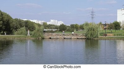 Lake in the park and fishermen - In the city landscape...