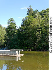 Lake Jetty - Jetty and jumping ramp over still lake surface....