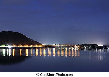 Lake Kawaguchiko at night with mount Fuji background, Japan