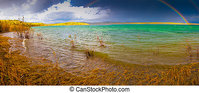 Lake Laberge rainbow dark clouds YT Canada - A Thundershower...