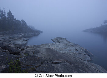 Lake Ladoga, Karelia, Russia - foggy morning in the...