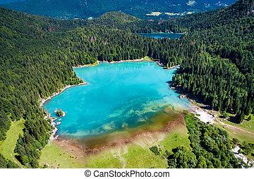 Lake Lago di Fusine Superiore Italy Alps. Aerial FPV drone...