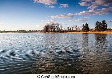 Beautiful polish lake landscape, tranquil rural countryside at springtime