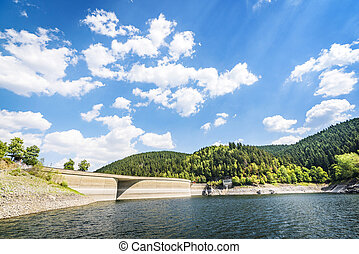 Lake landscape with a dam in summer
