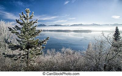 Lake Liptovska Mara covered in ice and Low Tatras mountains,...