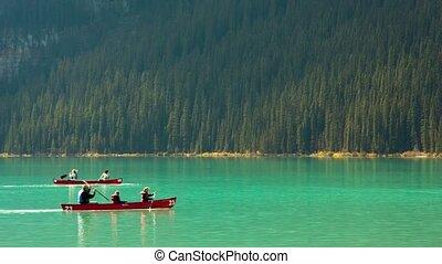 Lake Louise canoe - Floating on the lake Louise canoes,...