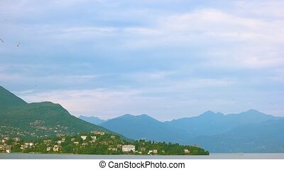 Lake Maggiore and Alps. Stresa town from distance.