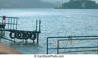 Lake Maggiore, small pier. Water and sunlight.