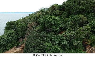 Lake Malawi shore to horizon panorama. Drone shot.