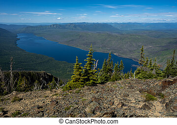 Lake McDonald spreads out in valley of Montana mountains