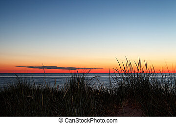 Lake Michigan Sunset - Grassy dunes on Lake Michigan are...