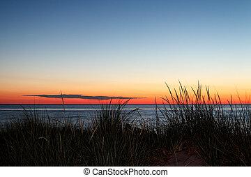 Lake Michigan Sunset - Grassy dunes on Lake Michigan are...