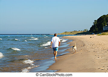 Lake Michigan USA - Walking the dog in the early morning on...
