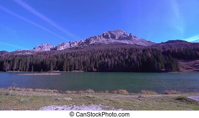 Lake Misurina with the forest and rocky mountains behind -...