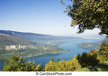 Panorama of Annecy's lake, view from Forclaz, with a paragliding far away