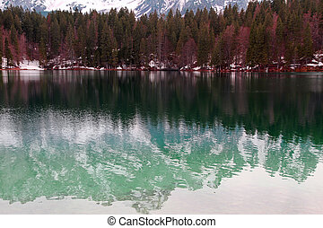 Lake of Fusine with the snowy Alps - beautiful Lake of...