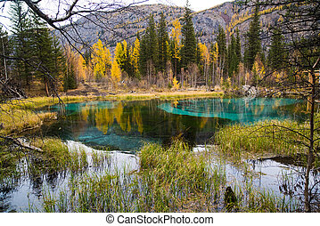 Lake of the Altai Republic. - A geyser lake in the autumn....