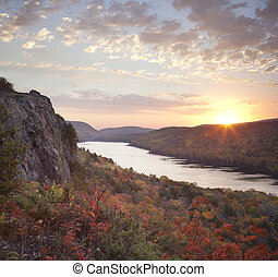 Lake of the Clouds, Michigan in peak fall color at sunrise -...