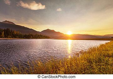 Lake on sunset - Sunset scene on lake