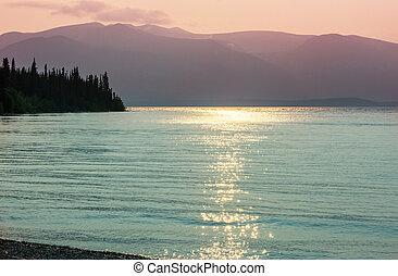 Lake on sunset - Sunset scene on the lake at sunset