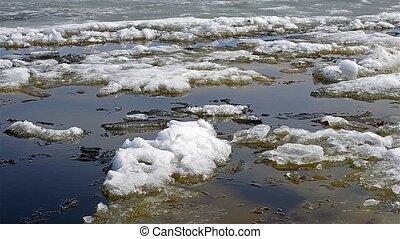 Lake Onega in Petrozavodsk, shackled by ice. Melting ice...