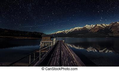 Lake pier at night
