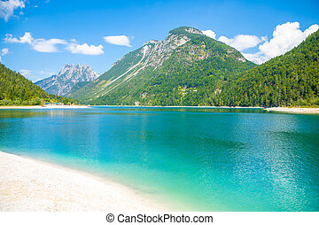 Lake Predil with turquoise water and mountains in background...