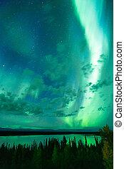 Lake Reflects Aurora Borealis Emerging Through Clouds Remote...