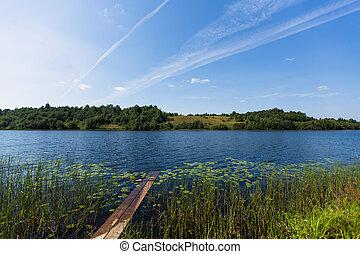Lake, rural landscape. Remote village in Karelia Republic, Russia.