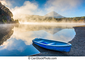 Lake Saiko, Japan on the shore with Mt. Fuji on a misty ...