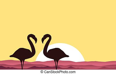 Lake scenery with flamingo silhouette