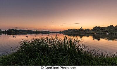 Lake Schulensmeer in Herk-de-Stad (Flanders, Belgium) at sunset