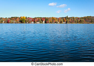 Lake side houses in the fall photographed in Lee MA in...