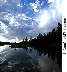 Lake Silhouette Pine Trees Clouds and Water