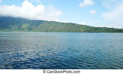 Lake. Sky. Motorboat. Time lapse.