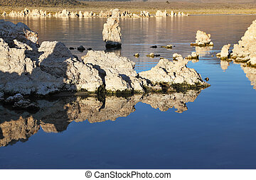 Lake stalagmites of the Tufa are reflected in water