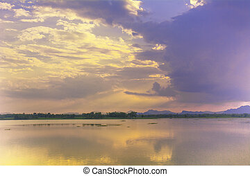 Lake summer view with reflection of clouds on water surface